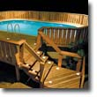 Picture of deck and stair lighting by a pool at night.
