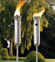 Picture of two stainless steel tiki torches.